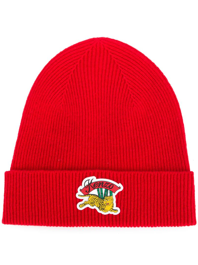 923ea2ac25c This red wool Jumping Tiger beanie from Kenzo features a front logo patch  ...
