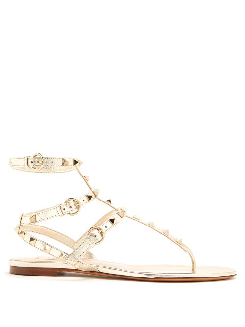 Valentino Rockstud Flat Leather Sandals In Gold