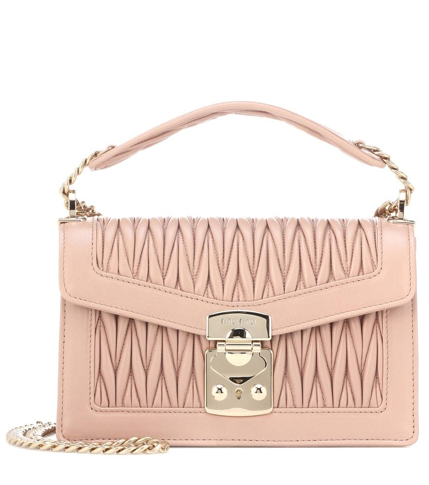 5d8ea3fc6f6f Add a ladylike touch to your accessories rotation with Miu Miu s powdery  pink leather shoulder bag. Working the label s signature plush matelassé  quilting
