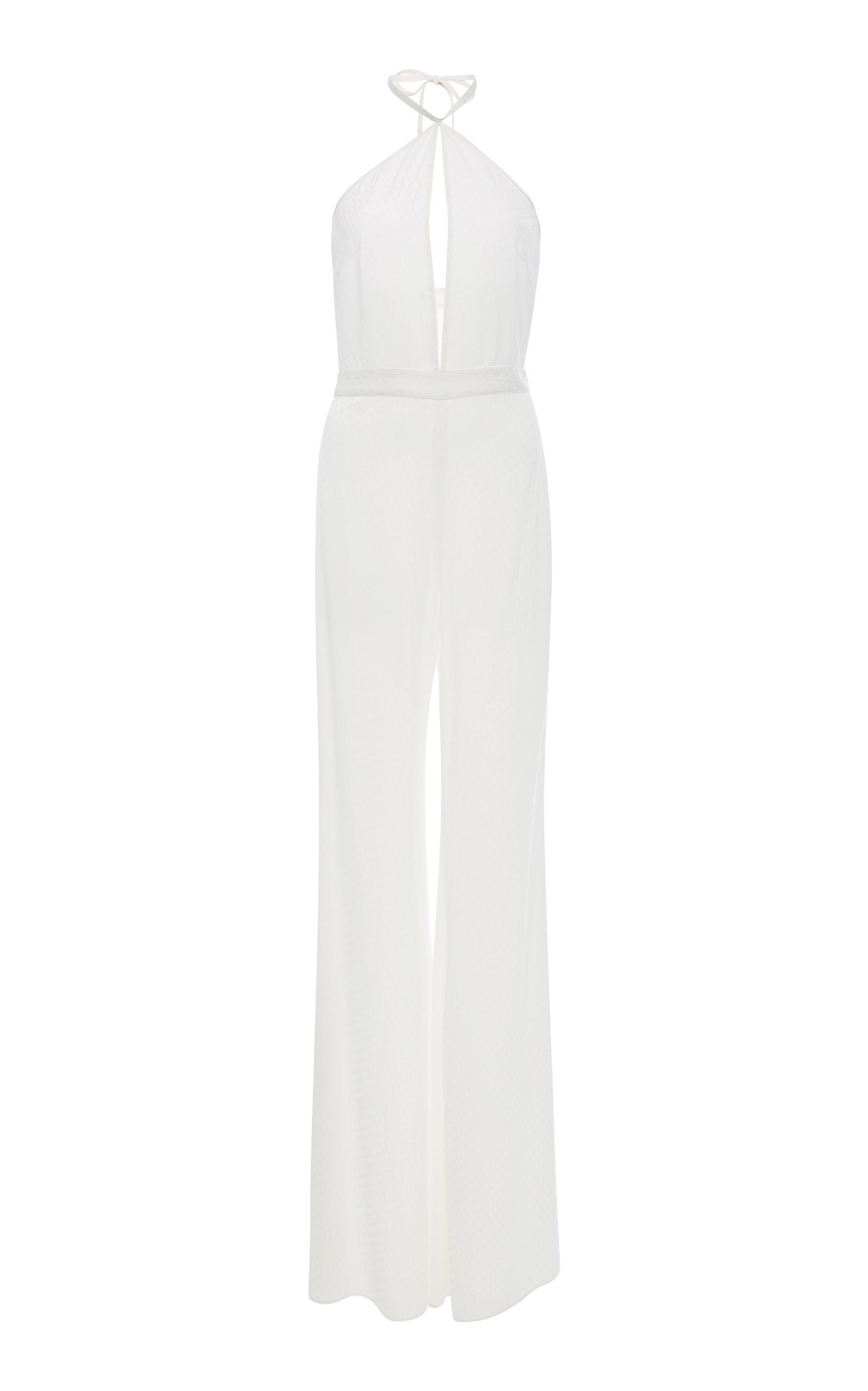 6cfa0f43a81 This Alexis Naila halter jumpsuit features a sleek silhouette with a halter  neckline front keyhole cutout and wide leg pants. Available From Looks