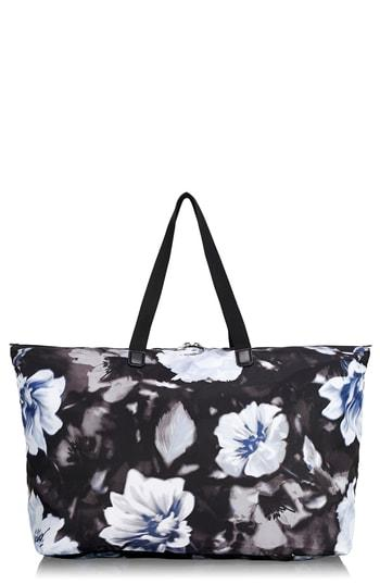 e4d4b4fd50 A spacious tote crafted from durable nylon packs neatly into a compact  zip-top pouch-perfect to slip into your suitcase or backpack as a spare bag.