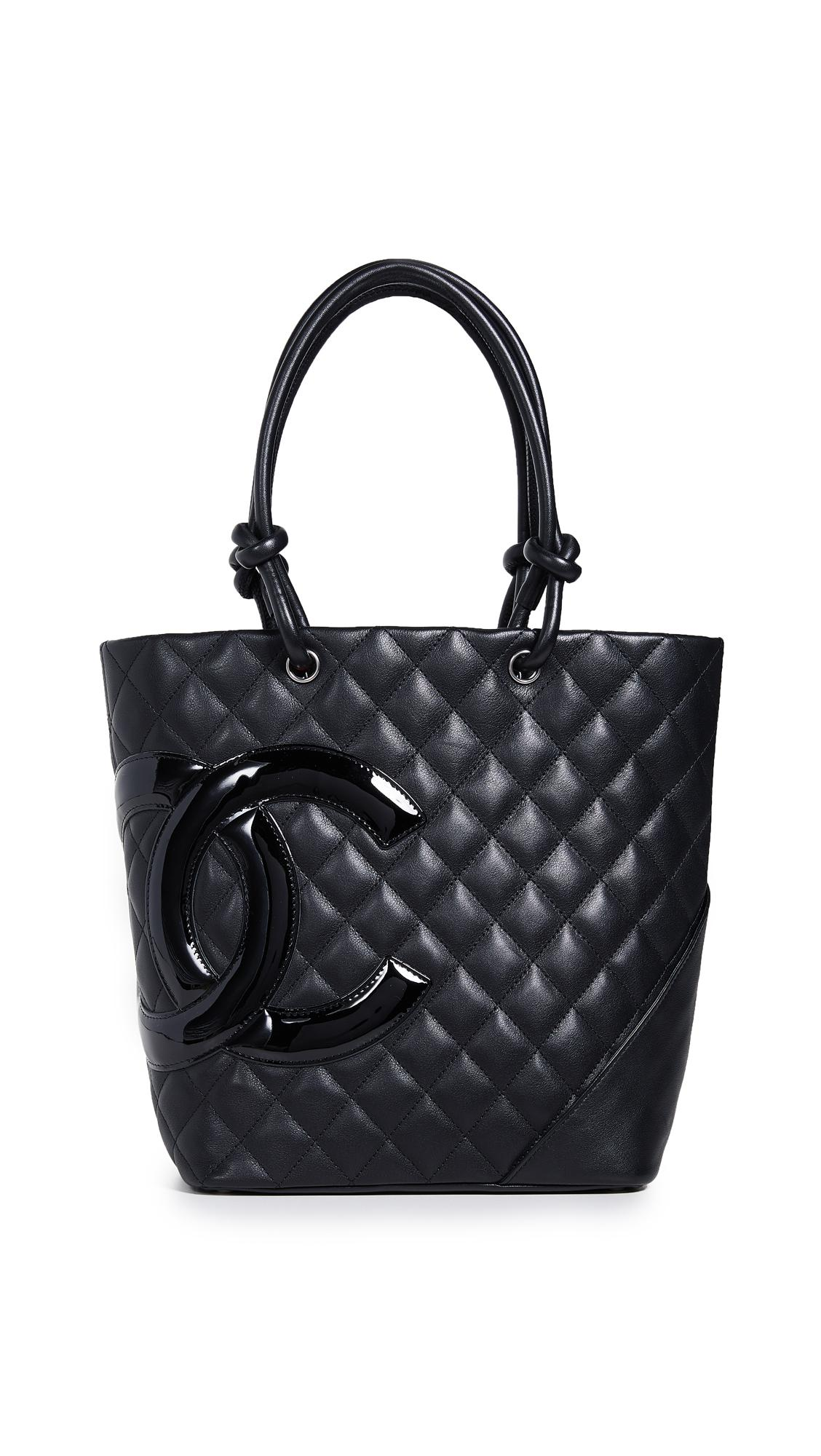 3427d68e88a85 EMERSON THORPE Macy Silk Flounce Dress in Polka Dot. Chanel Cambon Medium  Tote In Black