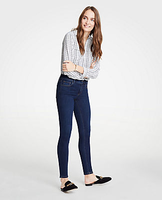 9aa87d5a60 ANN TAYLOR. Petite Performance Stretch Skinny Jeans In Mid Indigo Wash ...
