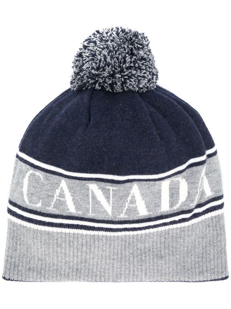 71cc99fd17d The Fall Winter navy and grey wool Canada beanie from Canada Goose features knit  Canada logo