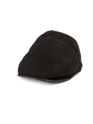 Classic newsboy fur cap with leather trim. Leather trim. Fur type  Real  sheepskin shearling. Fur treatment  Dyed Fur origin  Turkey 40c8c3f88651