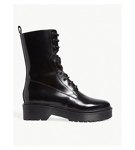 Maje Flat Leather Boots In Black