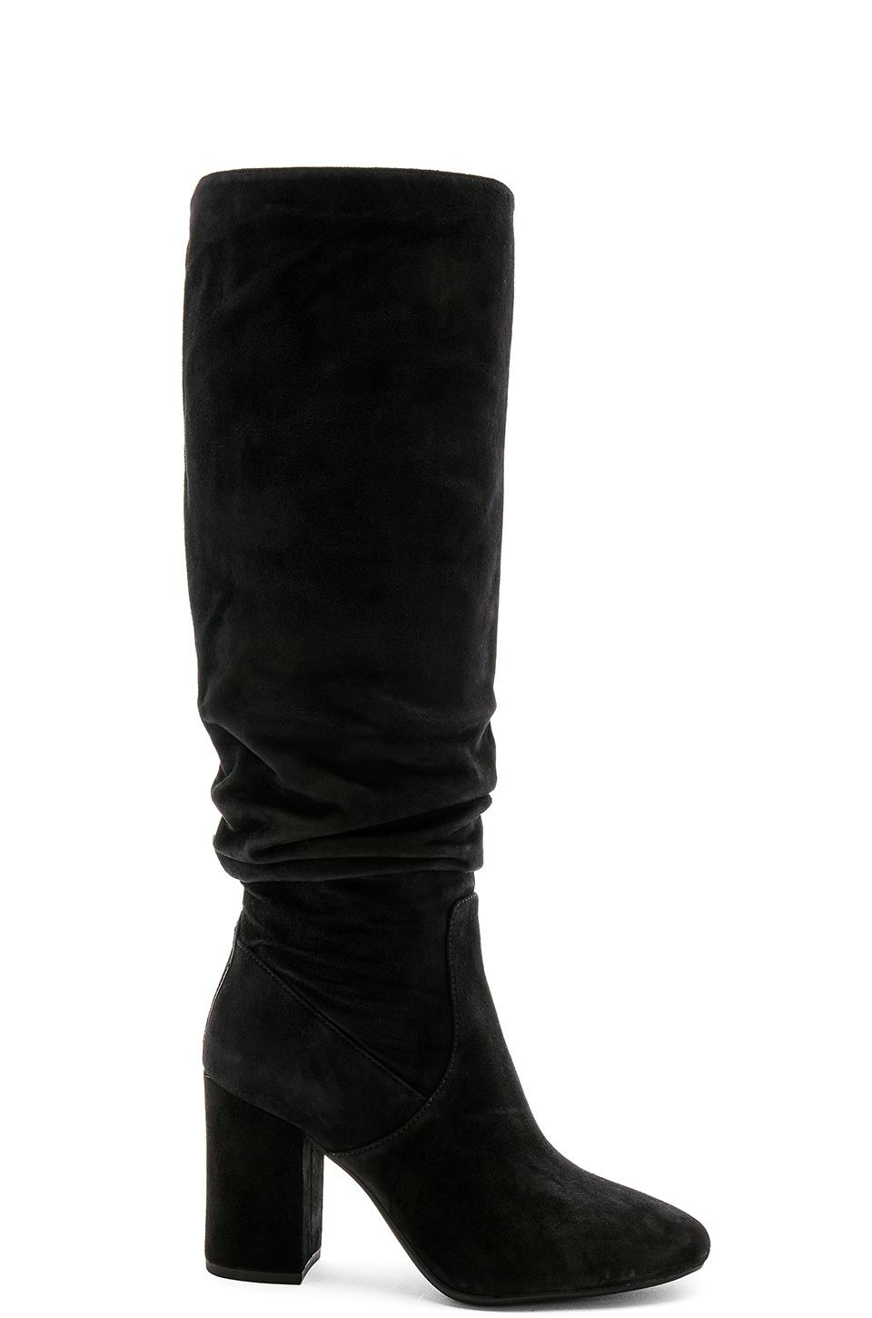 72b88583f63 These black suede Graham knee-high boots from Coach feature a round toe