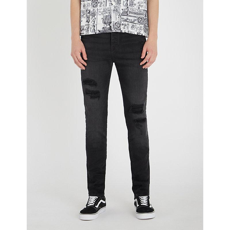 120818a0dc5 True Religion Rocco Relaxed-Fit Ripped Skinny Jeans In Black Destroyed