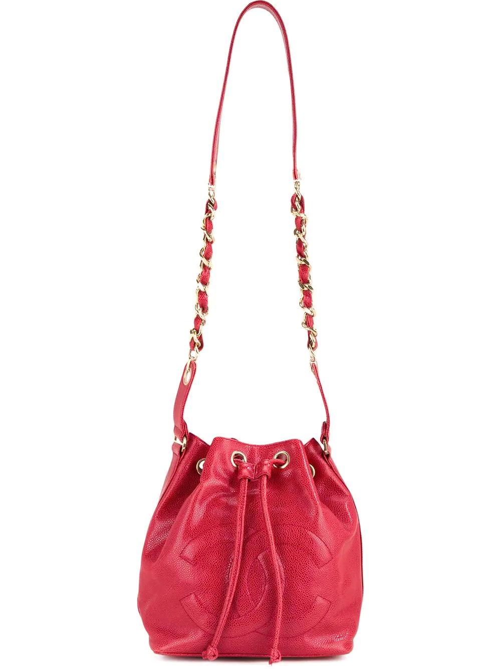 5badbbc9bb497d CHANEL. Chanel Vintage Cc Drawstring Chain Bucket Bag - Farfetch ...