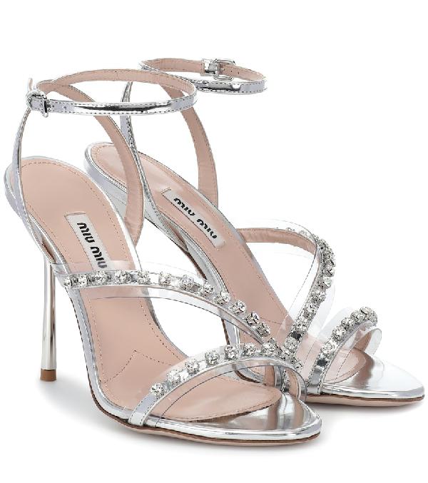 55f62133667482 Miu Miu Metallic Jeweled High-Heel Sandals In Silver