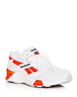 db61c219dfaa Reebok Women s Aztrek Low-Top Sneakers In White Black Solar Orange ...
