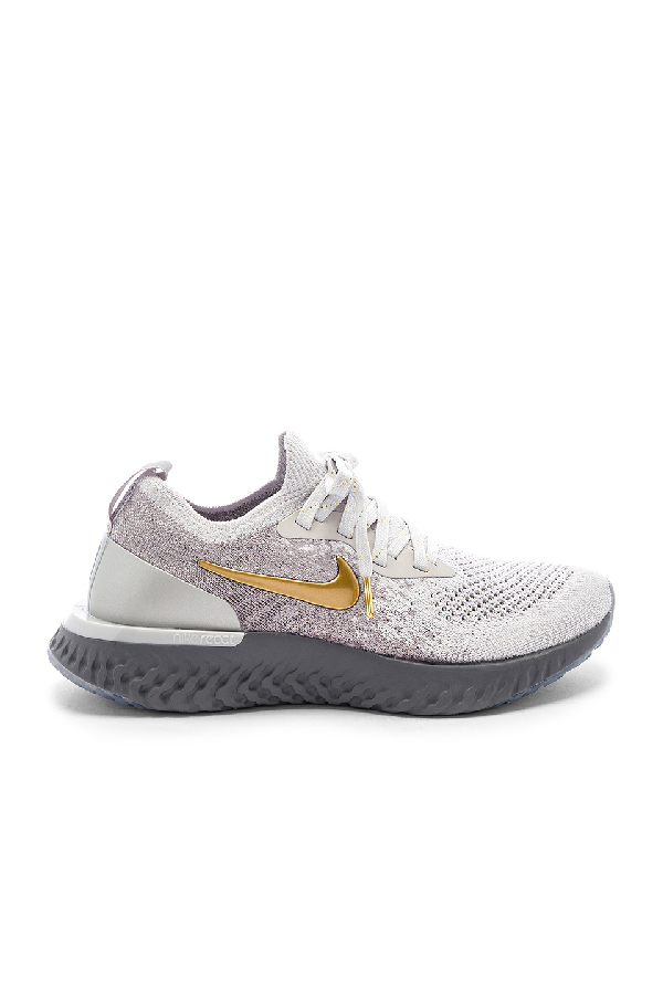lowest price 8a4c4 a3855 Nike Women s Epic React Flyknit Running Shoes, Grey In Vast Grey, Metallic  Gold