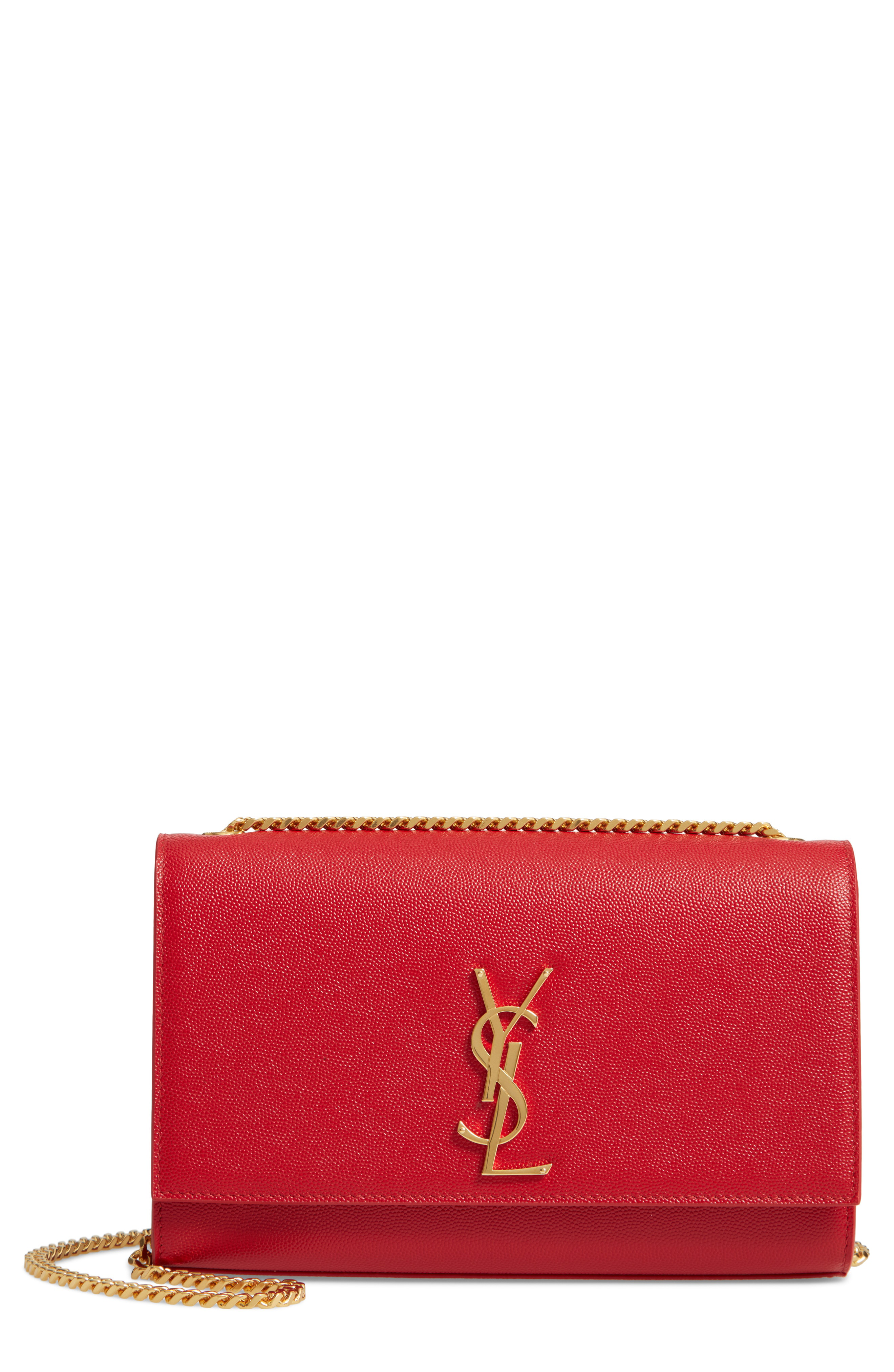 b38228b78dd9 ... serves as a luxe complement to the gleaming goldtone insignia on which  the design is centered— a simple and elegant nod to the Yves Saint Laurent  ...