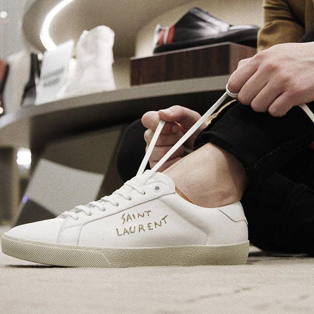 d5c284bccdbd SAINT LAURENT Sl 06 Court Classic Distressed Leather-Trimmed Embroidered  Canvas Sneakers in White